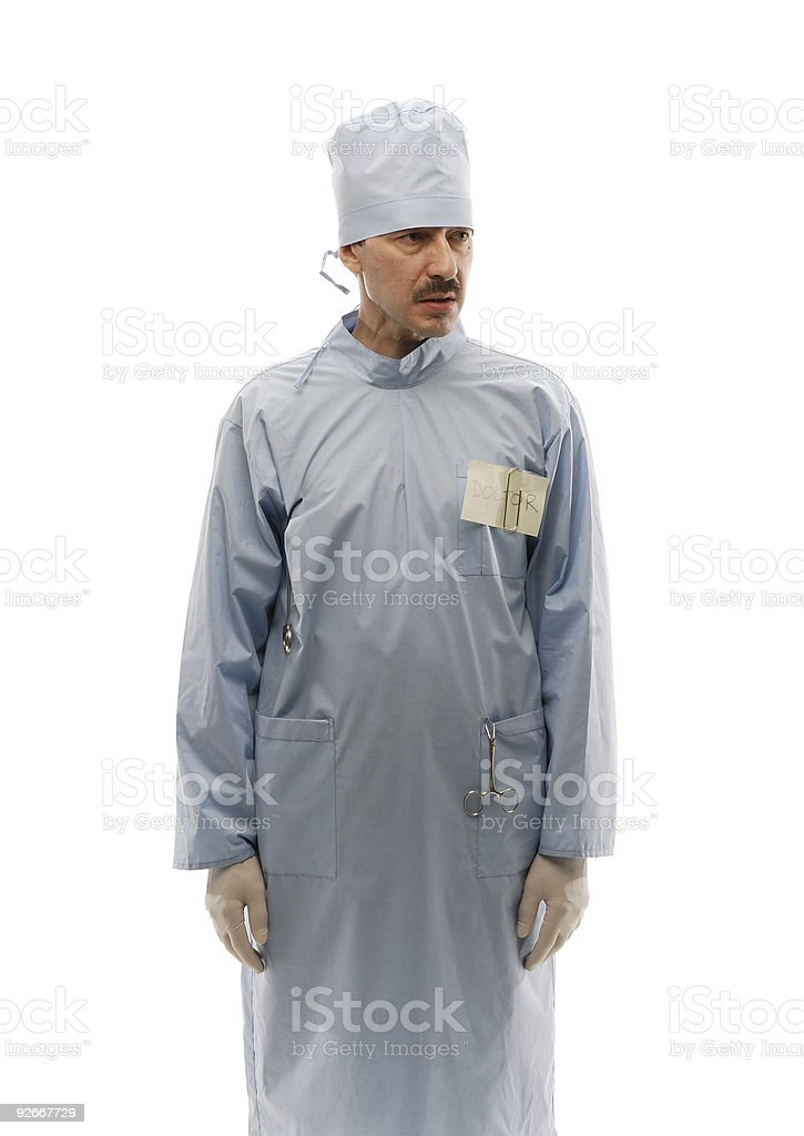 Doctor in blue robe standing still hands down royalty-free stock photo