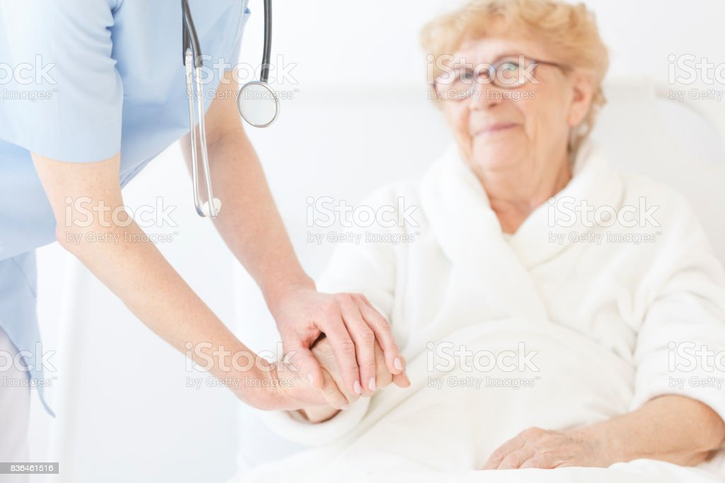 Doctor in blue uniform and with stethoscope stock photo