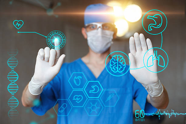 Doctor in blue uniform touch display with infographics. stock photo