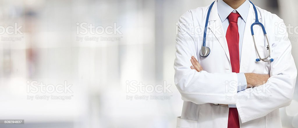 Doctor in front of a bright background stock photo