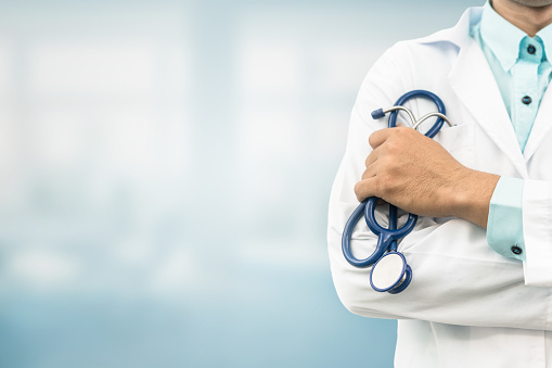 istock Doctor in hospital background with copy space 949812160