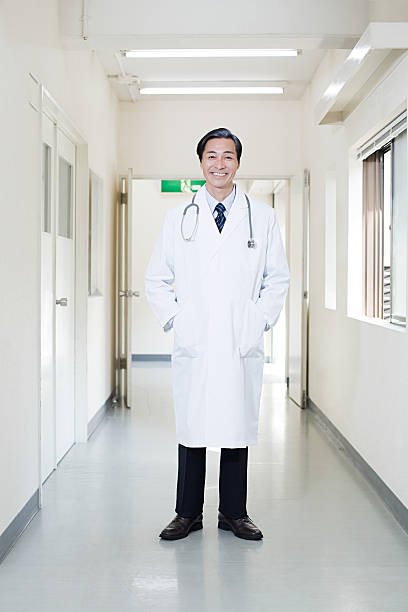 Doctor in hospital corridor stock photo