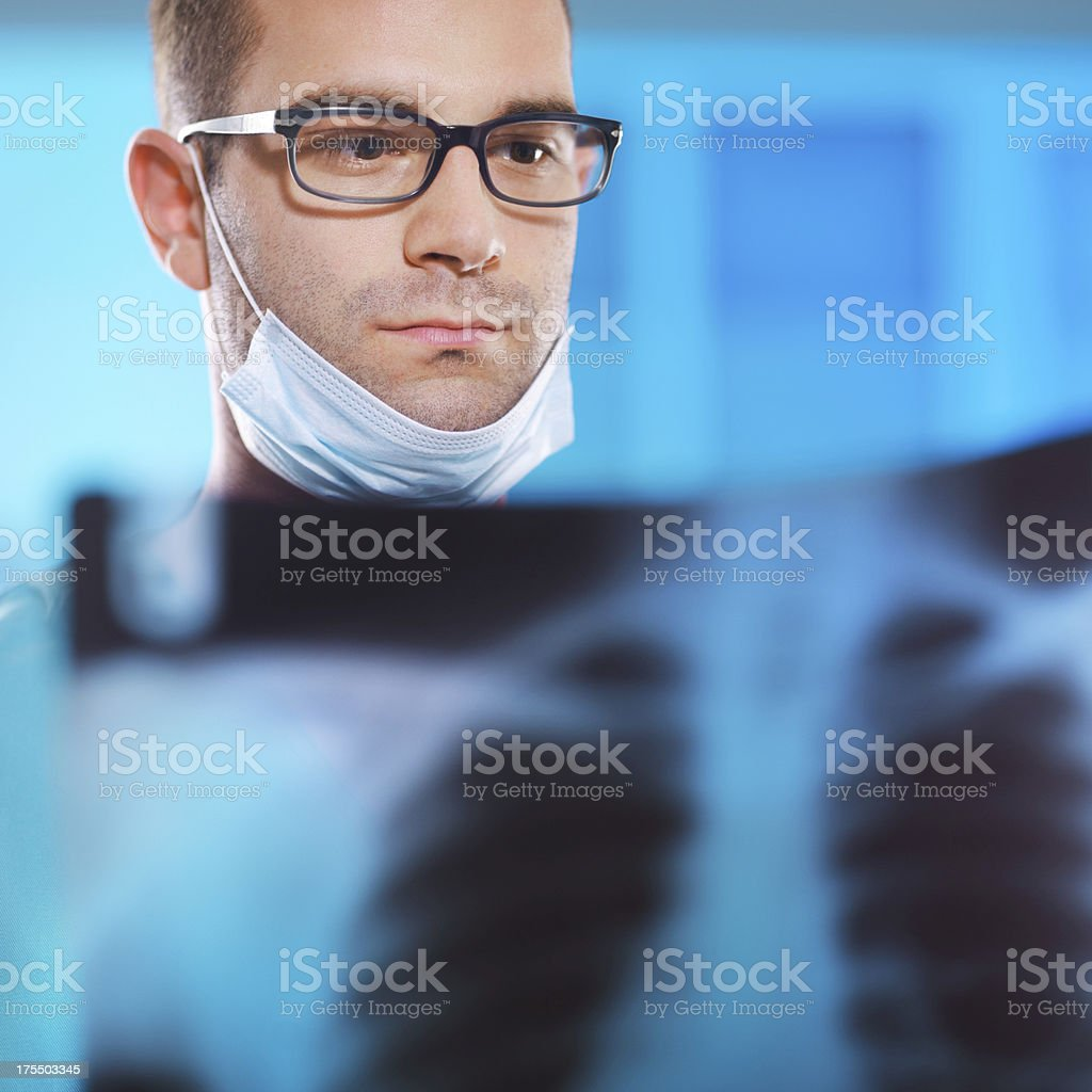 doctor in hospital looking on X-ray royalty-free stock photo
