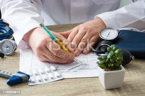 istock Doctor in hospital office prescribe prescription medication to patient who came to appointment. Control and monitoring of discharge of prescription drugs for pharmacotherapy pharmaceutical treatment 1139959815