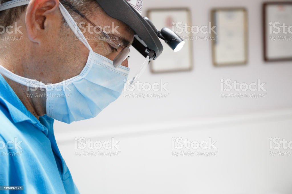 Doctor in process of work in dentistry royalty-free stock photo