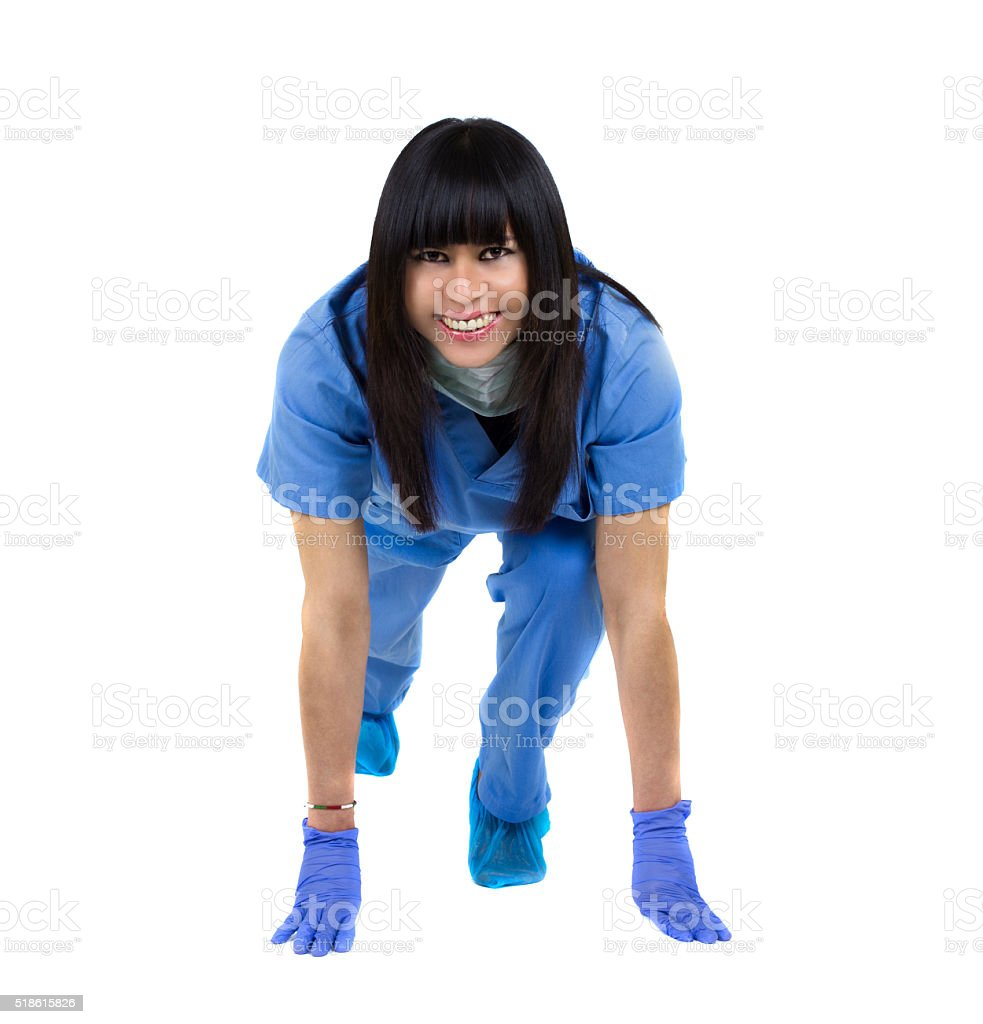 Doctor in sprint position stock photo