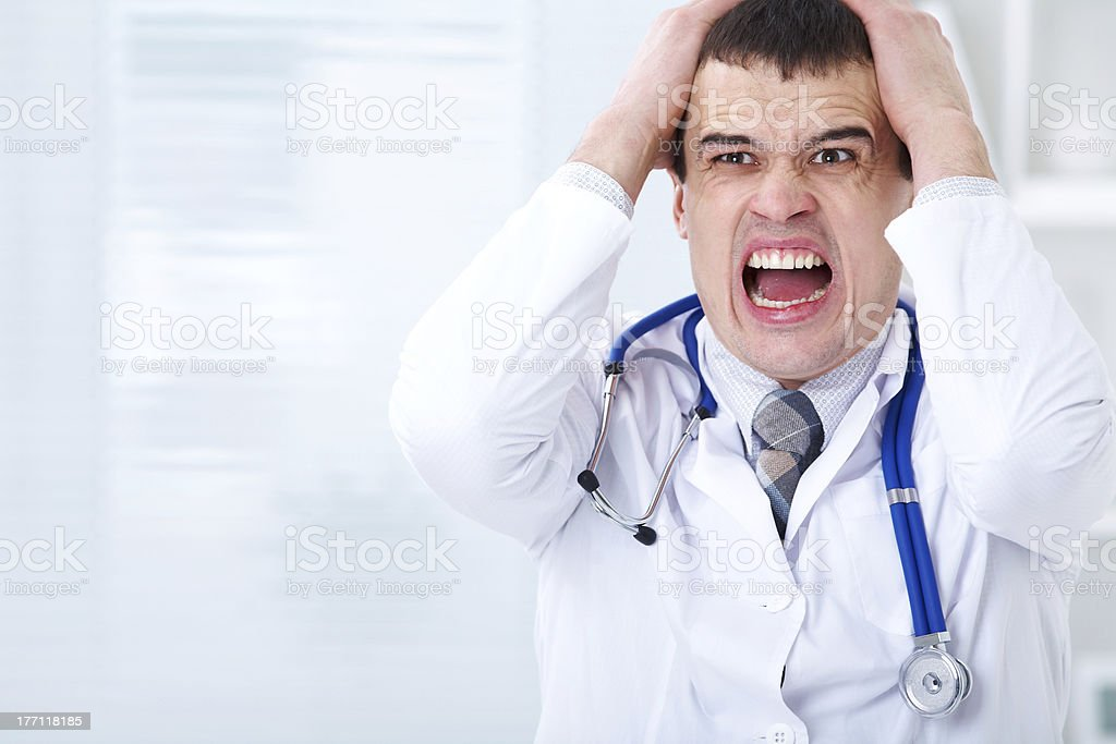 doctor in stress stock photo
