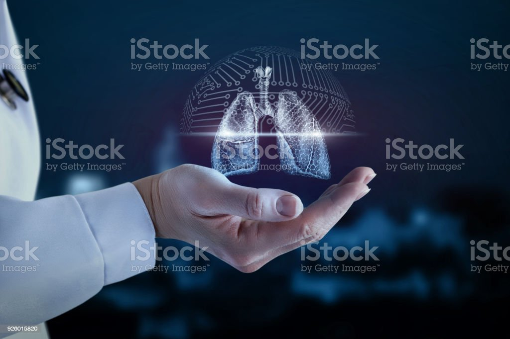 Doctor in the hand shows the scanning of the lung . stock photo