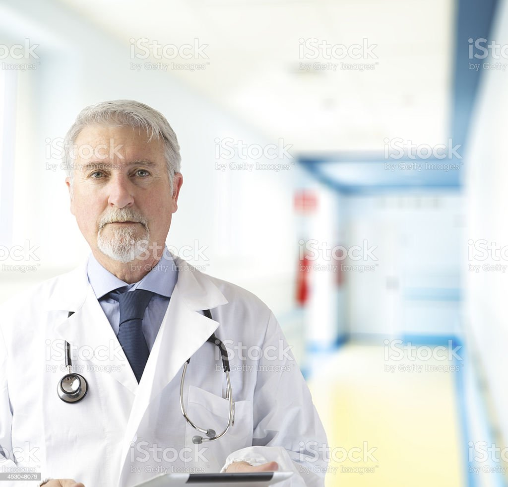 Doctor in the hospital hallway stock photo