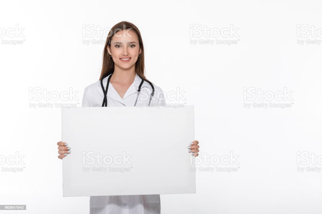doctor in white uniform holding blank board - Royalty-free Adult Stock Photo