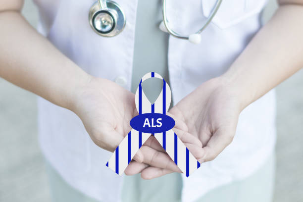 Doctor in white uniform with clinical stethoscope hold stripe blue and white ribbon awareness with text Stop ALS in hand for ALS or Amyotrophic Lateral Sclerosis Awareness Doctor in white uniform with clinical stethoscope hold stripe blue and white ribbon awareness with text Stop ALS in hand for ALS or Amyotrophic Lateral Sclerosis Awareness als stock pictures, royalty-free photos & images