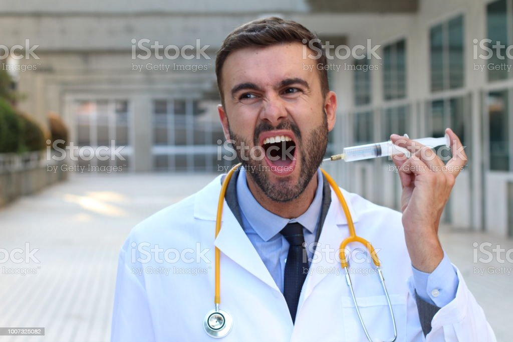 Doctor injecting himself in the hospital stock photo