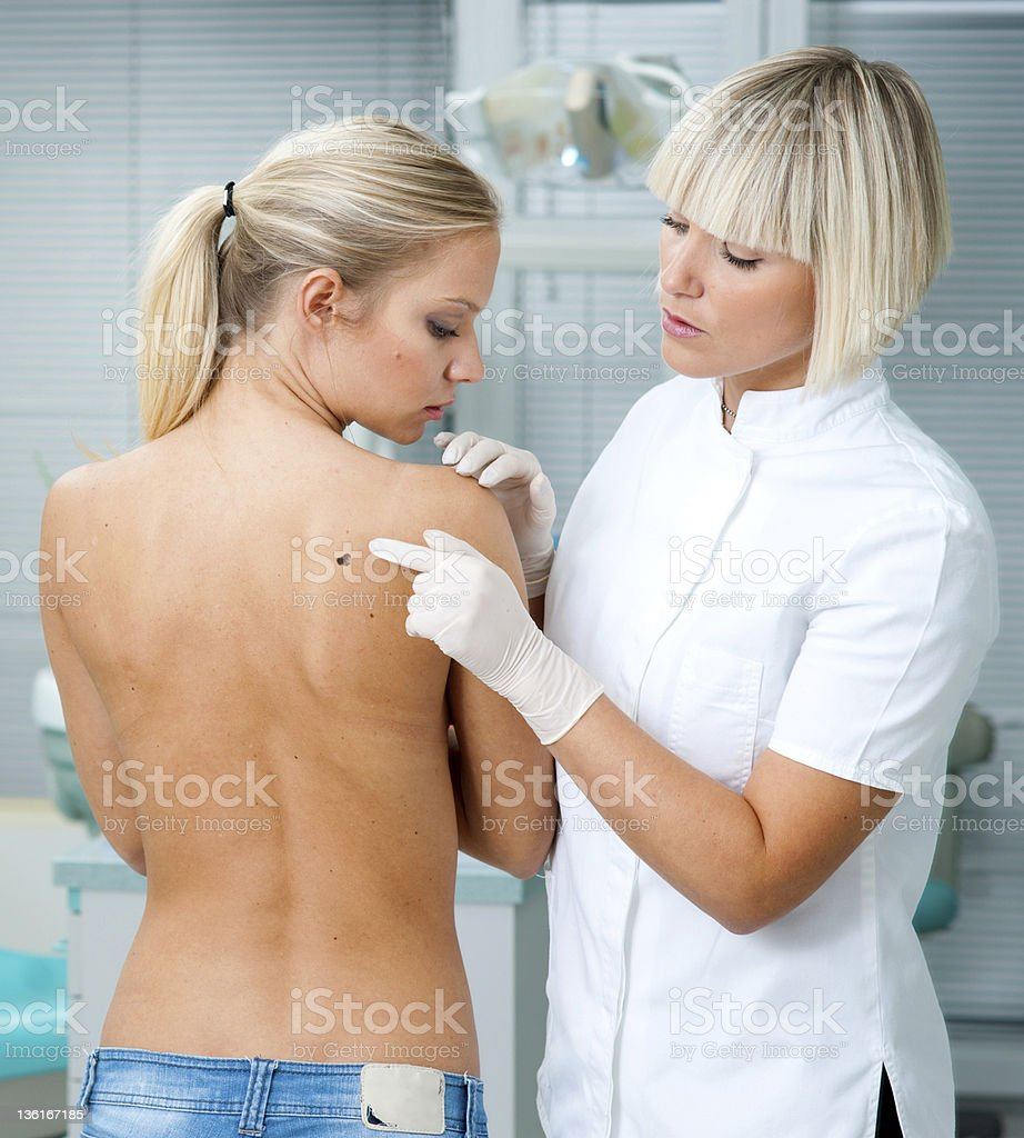 doctor inspecting woman patient skin royalty-free stock photo