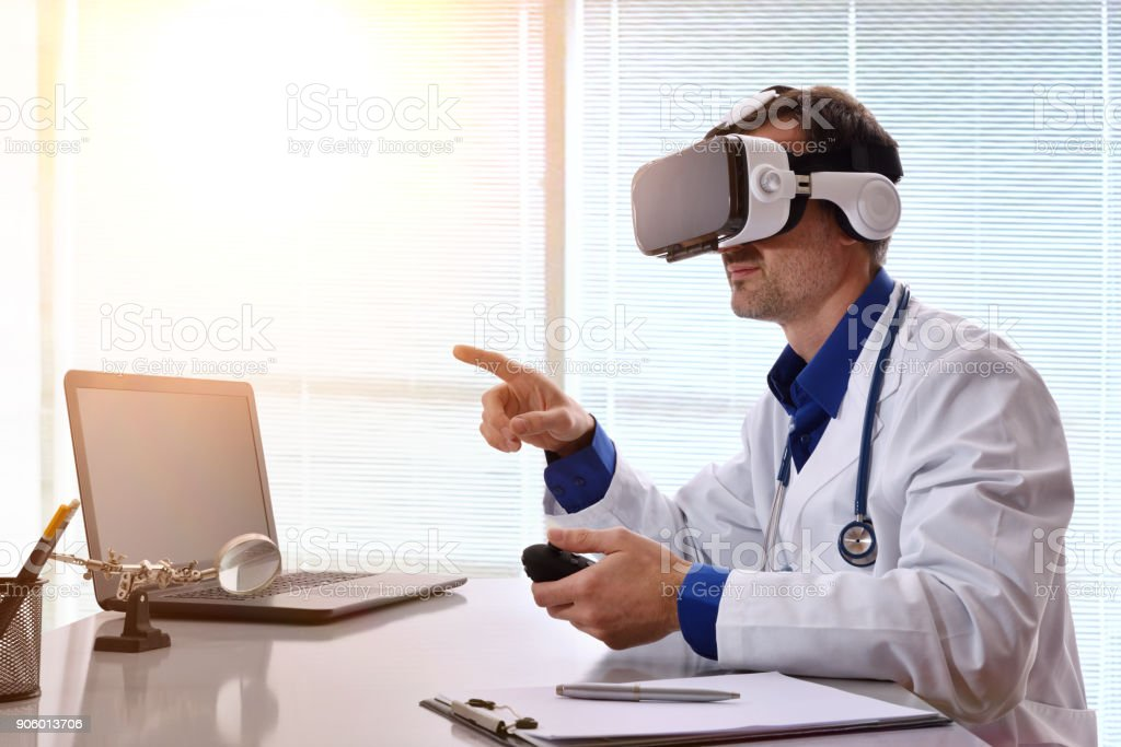 Doctor interacting with content 3d and virtual reality glasses stock photo