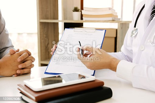 1026367516 istock photo Doctor is explaining the drug's properties to the patient and clarifying the correct use of the drug. 1225525082