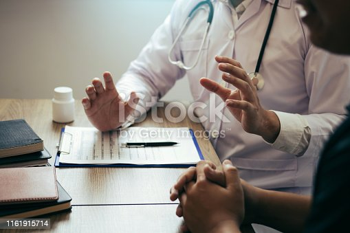 873418972istockphoto Doctor is explaining the treatment about the possible treatment of patients in the future. 1161915714