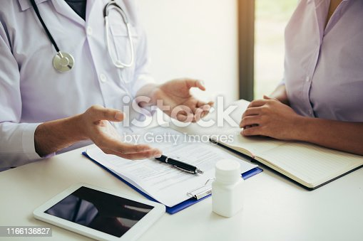 1026367516 istock photo Doctor is explaining the treatment about the possible treatment of patients in the future. 1166136827