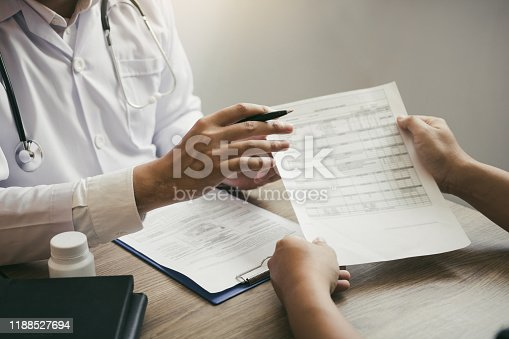1026367516istockphoto Doctor is explaining the treatment about the possible treatment of patients in the future. 1188527694