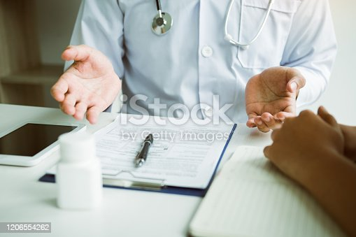 1026367516 istock photo Doctor is explaining the treatment about the possible treatment of patients in the future. 1206554262