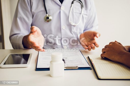 1026367516 istock photo Doctor is explaining the treatment about the possible treatment of patients in the future. 1213639865