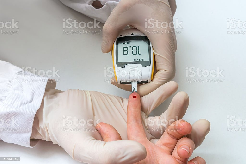 Doctor is testing patient\'s blood for glucose and sugar. Diabetes...