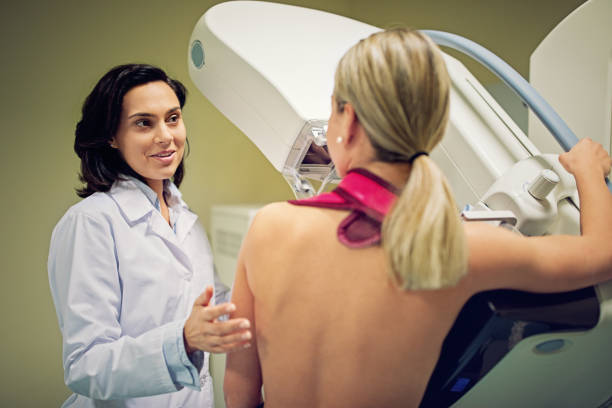 Doctor is working with mammography X-ray scanner in hospital Doctor is working with mammography X-ray scanner in hospital publicity event stock pictures, royalty-free photos & images