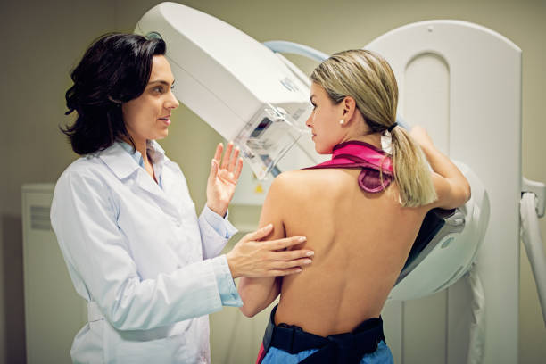 Doctor is working with mammography X-ray scanner in hospital stock photo
