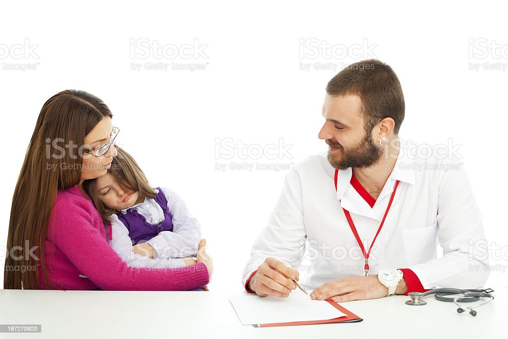 Doctor jotting and Explaining her test results she is puckering royalty-free stock photo