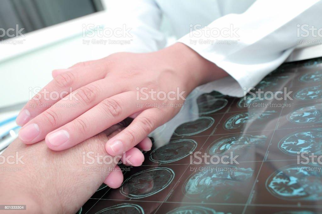 Doctor keeps hands of his patient stock photo
