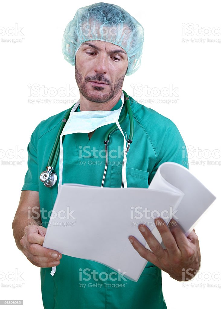 Doctor leafing a report stock photo