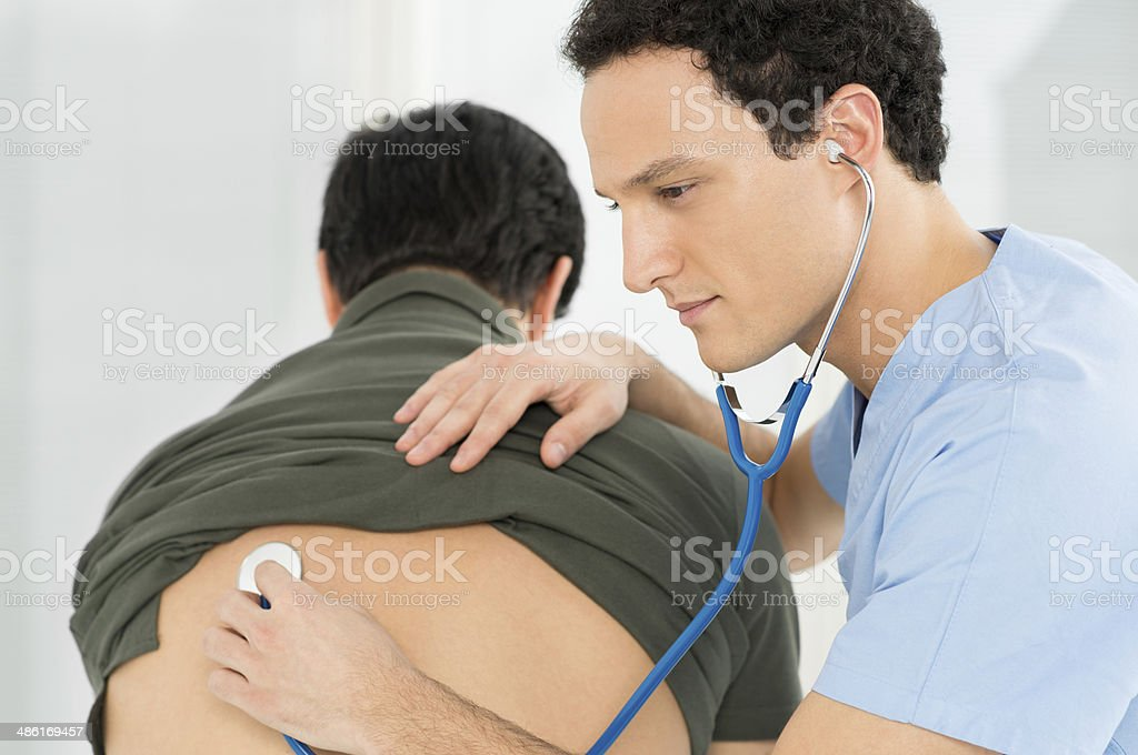 Doctor Listening The Patient's Lungs stock photo