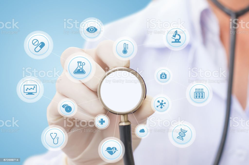Doctor listens and conducting a survey. stock photo