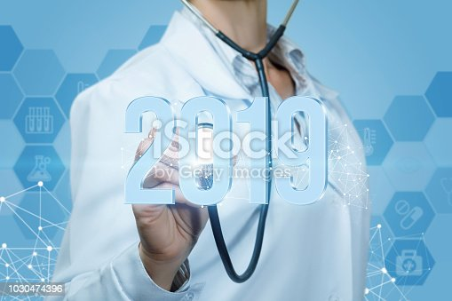 istock Doctor listens to 2019 figures on a blue background. 1030474396