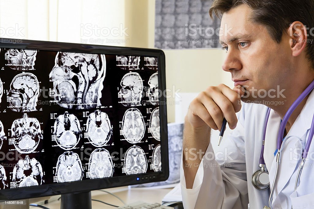 Doctor looking at ct scan royalty-free stock photo