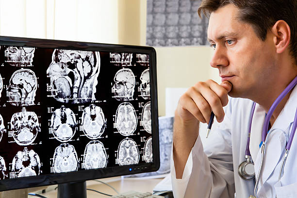 Doctor looking at ct scan stock photo