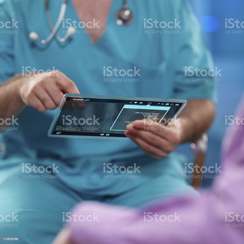 Doctor looking at digital tablet royalty-free stock photo