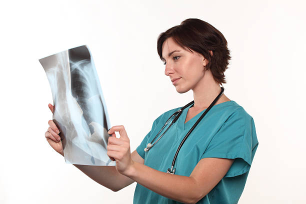 doctor looking at lungs x-ray - screening stock photos and pictures