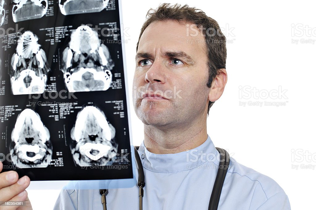 Doctor looking at MRI scan royalty-free stock photo