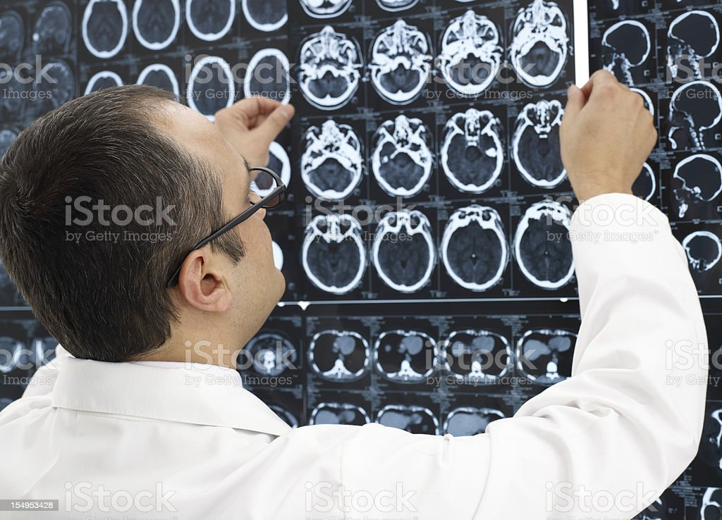 Doctor Looking at MRI scans royalty-free stock photo