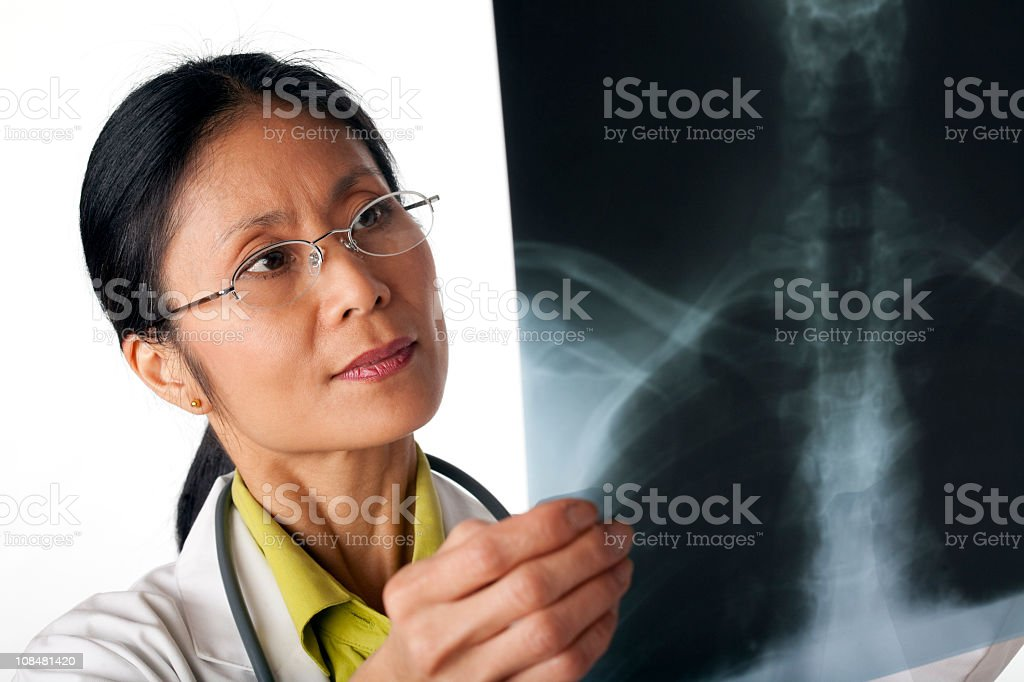 Doctor Looking at X-Ray. Isolated royalty-free stock photo
