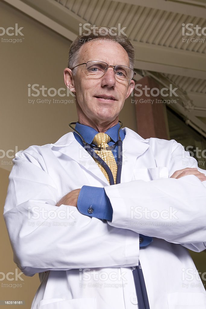 Doctor looking down over folded arms royalty-free stock photo