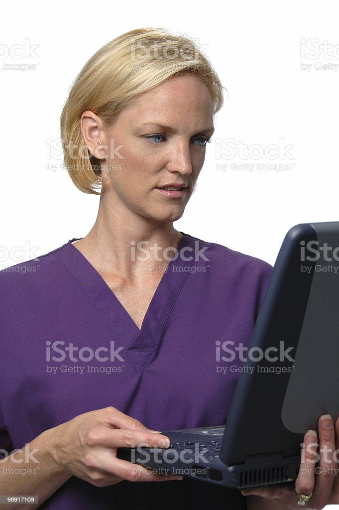 Doctor looking to a lap top computer royalty-free stock photo