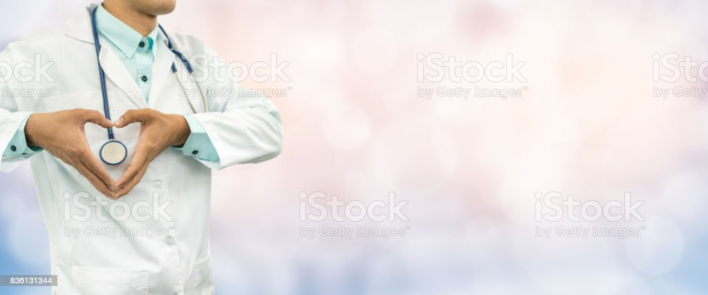 Doctor Makes Heart Sign by Hands stock photo