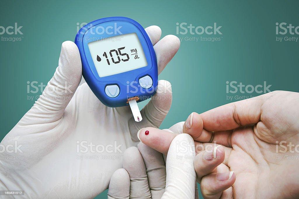 Doctor making blood sugar test royalty-free stock photo