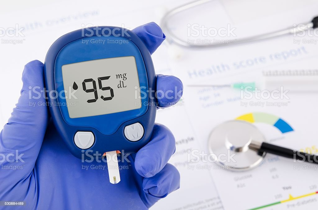 Doctor making blood sugar test. stock photo