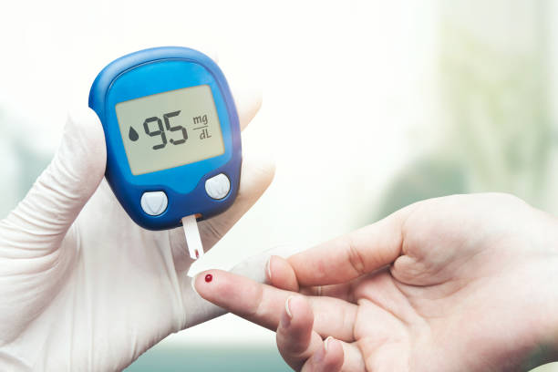 doctor making blood sugar test. - diabetic stock photos and pictures