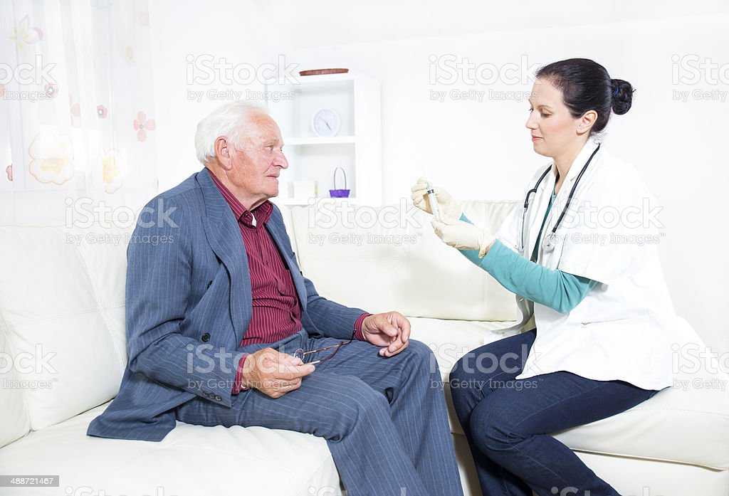 Doctor making blood test for senior man royalty-free stock photo