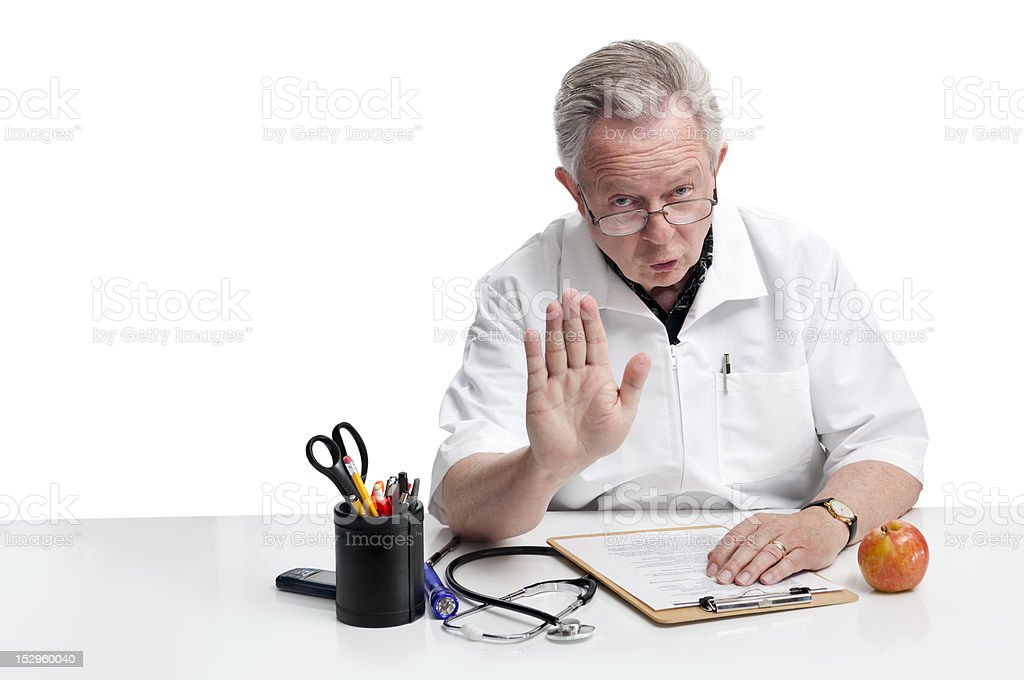 Doctor Making Eye Contact And Gesturing Stop stock photo