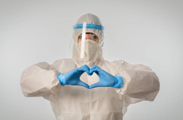 Doctor making heart shape and sending love during coronavirus COVID 19 novel corona virus outbreak stock photo