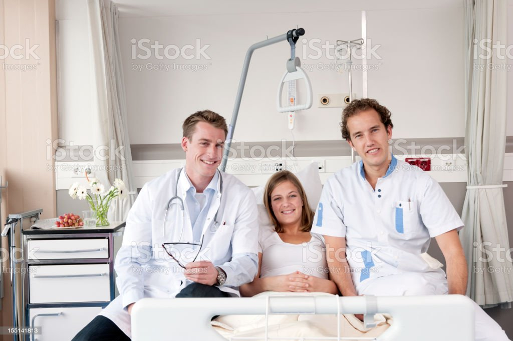 doctor, male nurse and female patient royalty-free stock photo